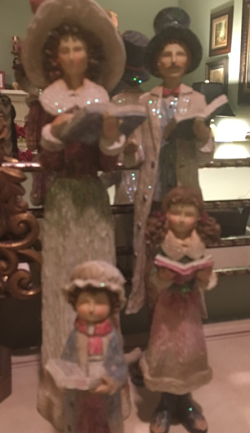 The Caroler figurines, before